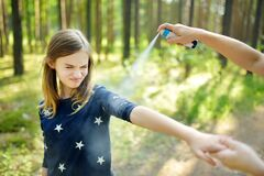 Free Mother Applying Insect Repellent To Her Daughter Before Forest Hike Summer Day. Protecting Children From Biting Insects At Summer Royalty Free Stock Photo - 176479795