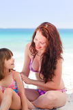 Mother applying sun cream on her daughter Royalty Free Stock Photo