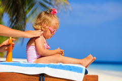Mother applying sunblock cream on daughter shoulder Stock Photography