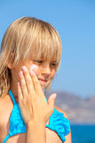 Mother applying sunscreen on her childs face Royalty Free Stock Photos