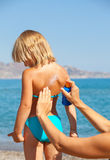 Mother applying sunscreen to her child Royalty Free Stock Image
