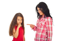 Mother arguing daughter. Mother arguing her daughter and pointing to girl isolated on white background stock image