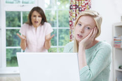 Mother Arguing With Teenage Daughter Over Online Activity Stock Image