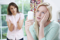 Mother Arguing With Teenage Daughter Over Use Of Mobile Phone Royalty Free Stock Images