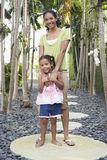 Mother With Arm Around Daughter On Stepping Stone Royalty Free Stock Photo