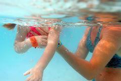 In mother arms. Young girl swimming in mother arms Royalty Free Stock Photo