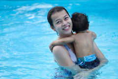 Mother and asian baby first time in a swimming pool Royalty Free Stock Photography