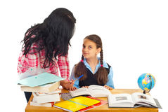 Mother asking girl about homework stock images