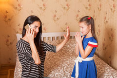 Mother asks the daughter to keep silent. Stock Images