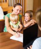 Mother and assistant arranging details Royalty Free Stock Photos