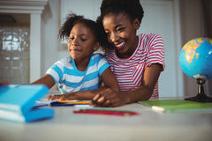 Mother assisting daughter with homework Royalty Free Stock Image