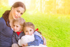 Mother with babies on backyard royalty free stock photography
