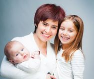 Mother with babies Stock Images