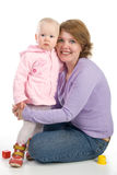 Mother with a baby. Mum embraces a small daughter Stock Photos