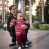 Mother and baby. A chinese mother is playing with her little cute baby Stock Photography