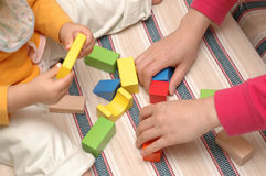 Mother and baby. A Chinese mother and her child are playing with wooden toy blocks Royalty Free Stock Images