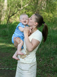 Mother with baby. In the park Royalty Free Stock Photo