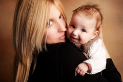 Mother and baby. Young mother hold her baby girl   studio shot Royalty Free Stock Photos