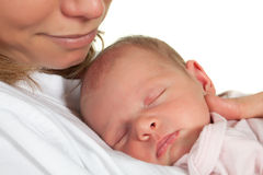 Mother and baby. Young mother watching her sleeping 18 days old baby Stock Photos