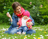 Mother with baby. In the park Stock Images