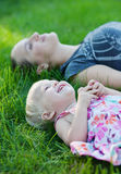 Mother and baby. Mother and her baby lying on the grass Stock Photo
