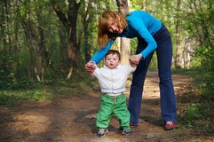 Mother and Baby. Cute baby learnig to walk Royalty Free Stock Images