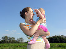 Mother with baby. On blue sky royalty free stock photo