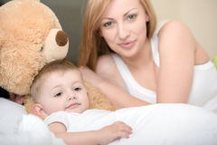 Mother and baby. Mother playing with small baby Royalty Free Stock Photos