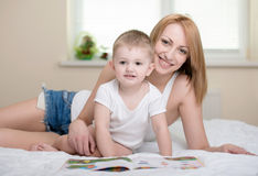 Mother and baby. Happy mother with baby reading book Stock Image