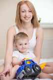 Mother and baby. Mother playing with small baby Stock Photography