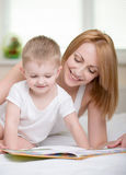 Mother and baby. Happy mother with baby reading book Stock Photography