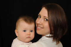 Mother with baby Stock Images