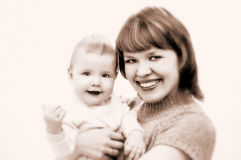 Mother and baby. In sepia royalty free stock images