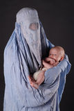 Mother and baby. Portrait  of mom with her son in Afghan burka Stock Photos