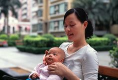 Mother and baby. A chinese mother is playing with her little cute baby Stock Images
