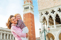 Mother and baby against campanile di san marco. Portrait of happy mother and baby against campanile di san marco in venice, italy Royalty Free Stock Image