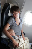 Mother with baby at airplane Stock Photos