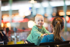 Mother And Baby At Airport. Royalty Free Stock Images