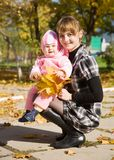 Mother with  baby  in autumn Royalty Free Stock Photography
