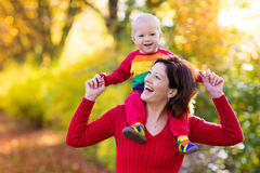 Mother and baby in autumn. Fall outdoor family fun. Stock Images