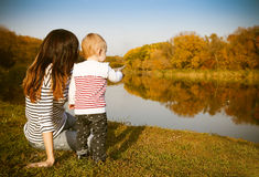 Mother and baby on autumn lake Stock Image