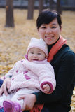 Mother and baby in autumn park. Chinese mother and baby in autumn park Stock Photo