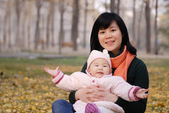 Mother and baby in autumn park Stock Photography