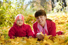Mother and   baby  in autumn park Royalty Free Stock Photo
