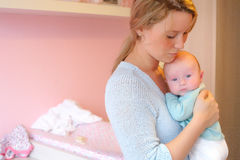 Mother and baby in the babyroom Stock Images