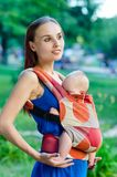 Mother and baby. In backpack. Outdoor Royalty Free Stock Photography
