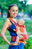 Mother and baby. In backpack. Outdoor Stock Photography
