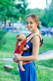 Mother and baby. In backpack. Outdoor Royalty Free Stock Photos
