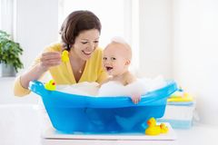 Mother and baby in bath royalty free stock photo