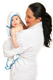 Mother and baby in bathrobes Stock Photos
